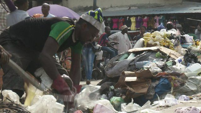 Man picking through rubbish