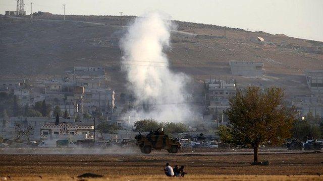 smoke rises from Kobane, seen from Turkish border