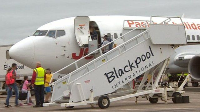 Passengers boarding an aircraft at Blackpool Airport