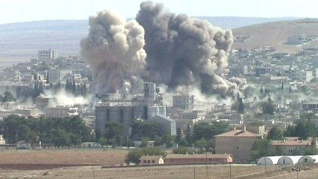 two smoke plumes rise above Kobane, Syria