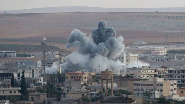 Smoke rising after an airstrike by an alleged alliance war plane targeting the Islamic State in the west of Kobane