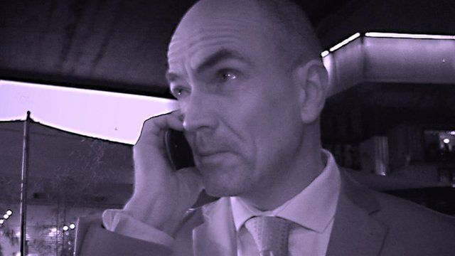 An actor holding a mobile phone in interactive theatre experience Fifth Column