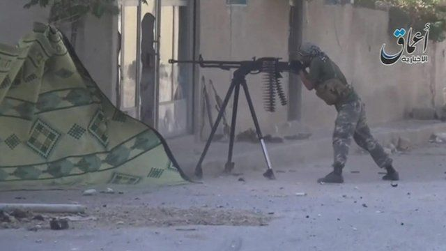 Still from IS video showing man with gun in Kobane
