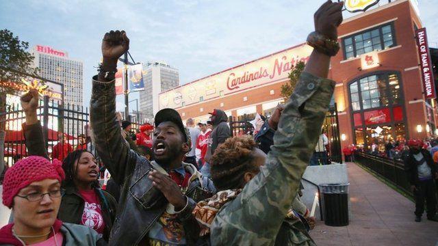 Protesters utside Busch Stadium, St Louis 11 October 2014