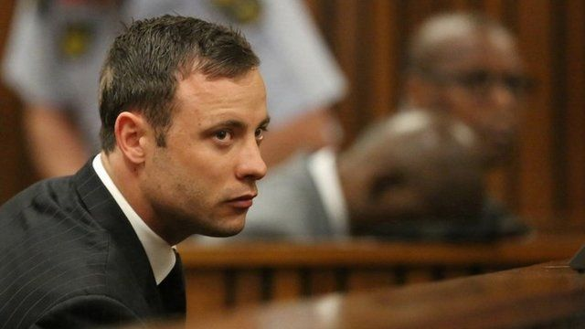 Oscar Pistorius sits in the dock in court in Pretoria