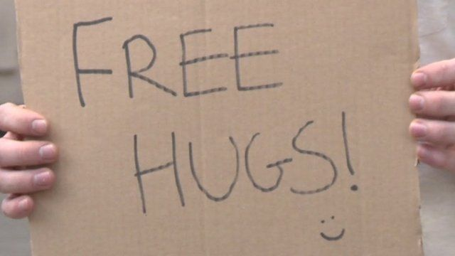 Sign saying Free Hugs