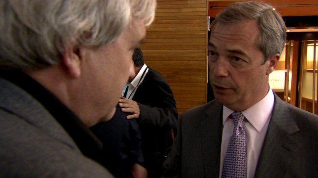 Darragh MacIntyre approaches Farage at the EU Parliament.