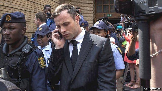 Oscar Pistorius leaves court on 13 October 2014