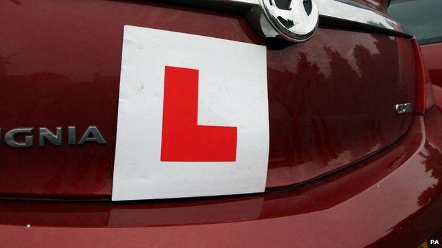 Learner driver displays L plate on car