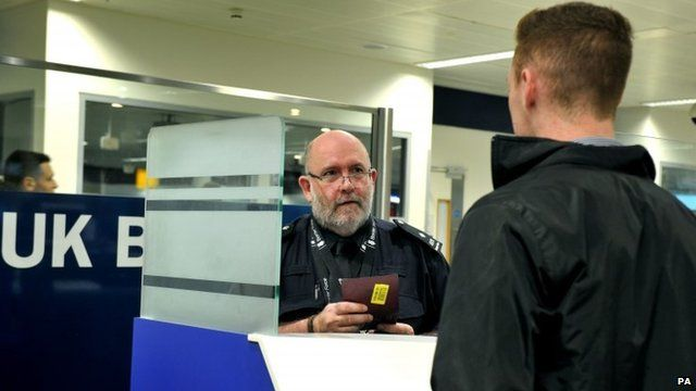 Photo issued by Public Health England of actor posing as a passenger being screened at Heathrow airport