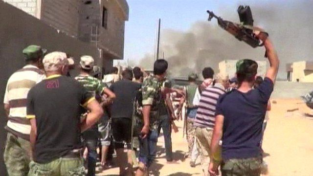 Militia group hold up weapons in Libya