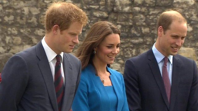 File picture of the Duke and Duchess of Cambridge, and of Prince Harry (L)