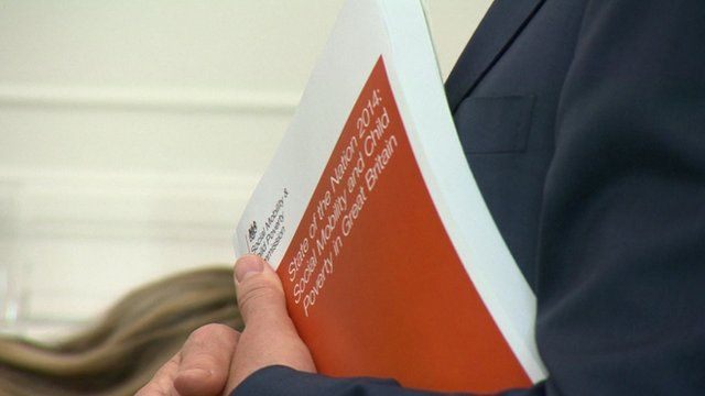 Close up shot of Alan Milburn holding copy of State of the Nation 2014 report
