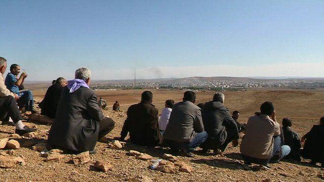 Kurds watch fighting in Kobane