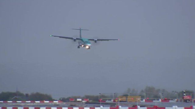 Plane landing at Manchester Airport in stormy weather