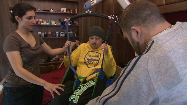 Daniel Nicholls, who was paralysed from the neck down in a diving accident in 2003, being lifted in a sling