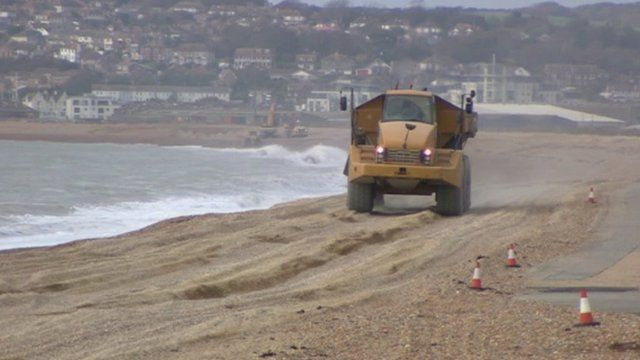Truck dumping shingle on Seaford beach