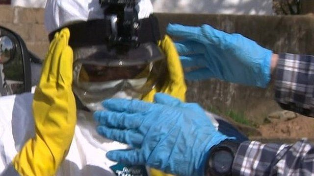 Man in mask to protect against Ebola