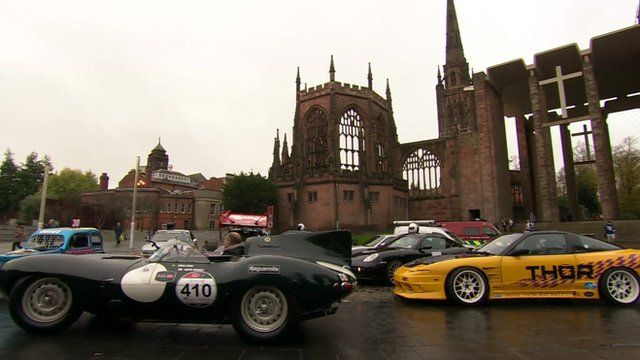 Motor cars in front of Coventry cathedral