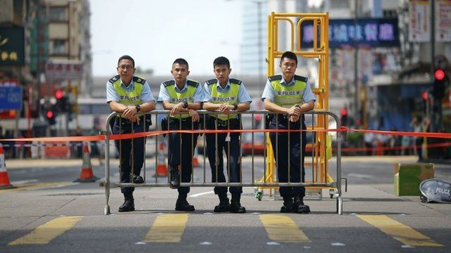 Policemen control the area on the edge of a pro-democracy protest in Hong Kong