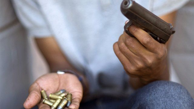 South African gang member holds gun