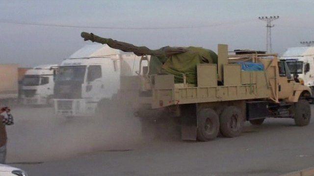 Truck carrying a large artillery gun