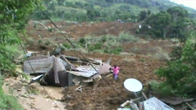 Destroyed house on slope where landslide struck
