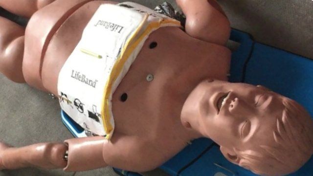 Mannequin with LifeBand chest compression device