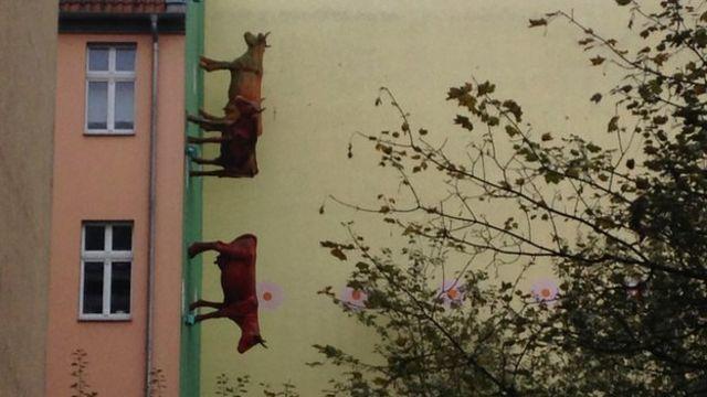 Cows on a wall in a funky Berlin neighbourhood
