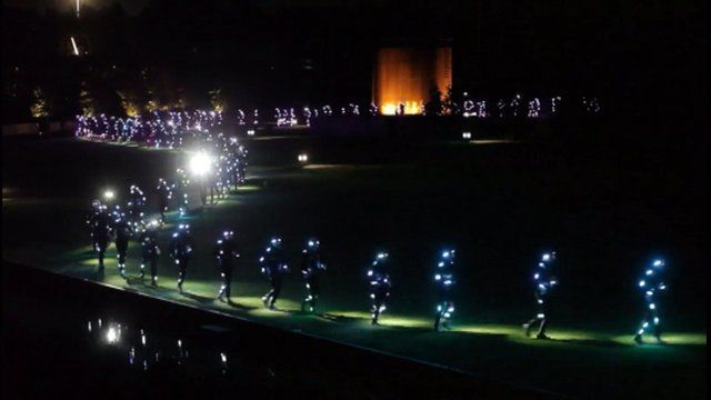 Runners in light suits