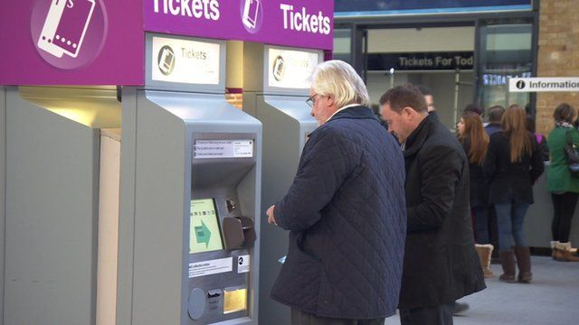 Commuters at a ticket machine
