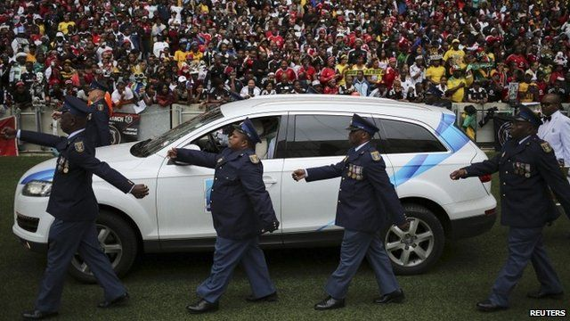 A hearse arrives at the Moses Mabhida stadium ahead of a funeral service of South African national soccer team captain and goalkeeper, Senzo Meyiwa,