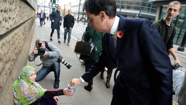 Ed Miliband gives money to a beggar in Manchester
