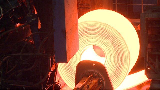 Close up of roll of heated steel at steelworks in eastern German town of Eisenhuttenstadt