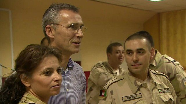 Jens Stoltenberg and troops