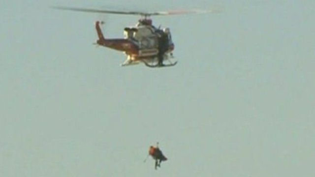 Winched to safety by helicopter