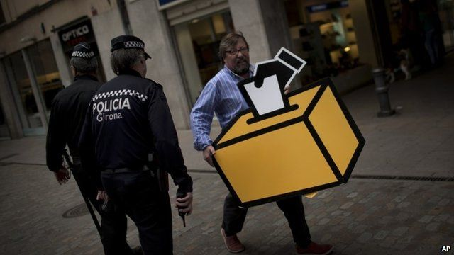 Man carrying picture of ballot box