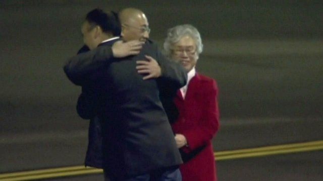 Kenneth Bae is greeted upon landing in the US