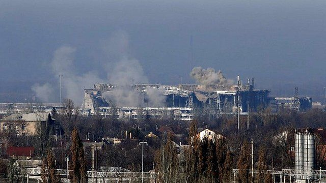 Smoke rises above a new terminal of the Sergey Prokofiev International Airport after shelling during fighting between pro-Russian separatists and Ukrainian government forces in Donetsk