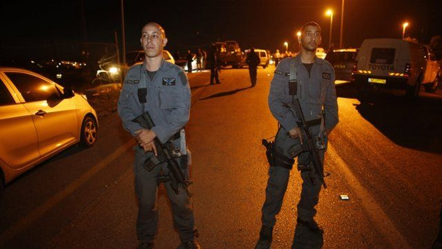 Israeli police officers stand guard at the scene of a stabbing attack near the West Bank Jewish settlement of Alon Shvut
