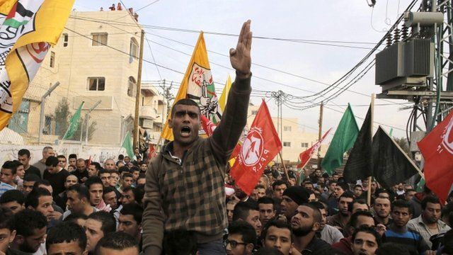 A mourner chants slogans during the funeral of 21-year-old Palestinian man Mohammed Jawabreh, whom medics said was shot dead by Israeli troops during clashes