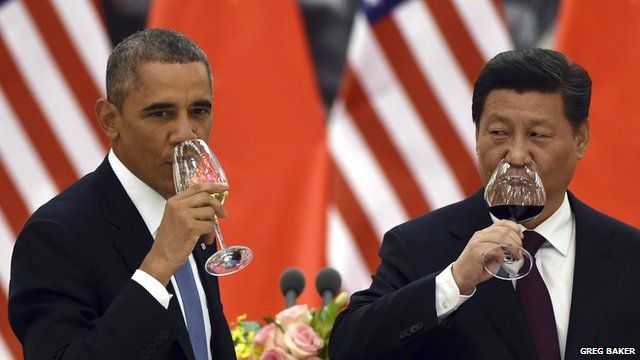 President Obama and China's President Xi drink a toast at a banquet in Beijing