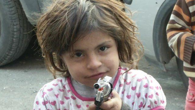 Child with toy gun