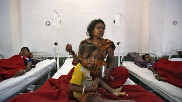 Women, who underwent a sterilisation surgery at a government mass sterilisation lie in hospital beds
