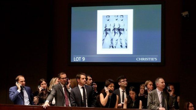 Andy Warhol's Triple Elvis (Ferus Type) sells at Christies Auction house in New York