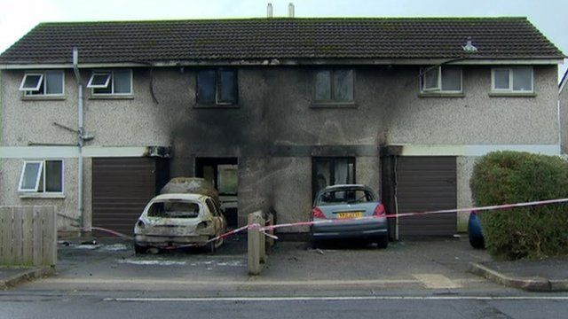 The fire badly damaged both houses and two cars, as Claire Savage reports