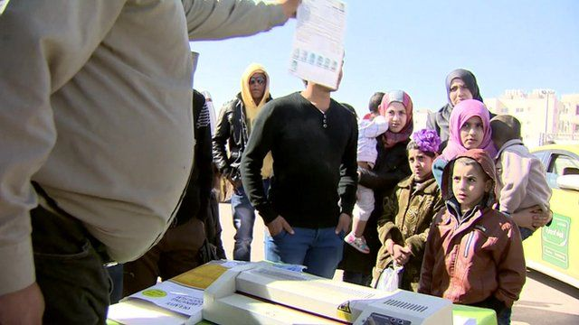 Syrian refugees at a border crossing