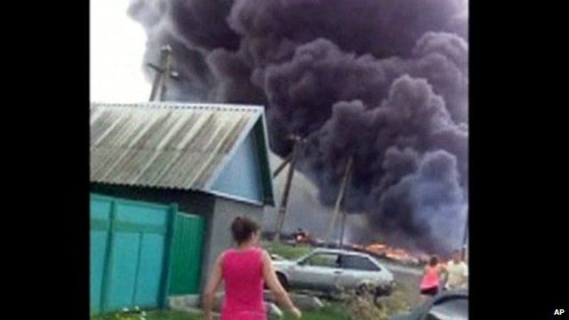 Smoke plumes rise after MH17 crash
