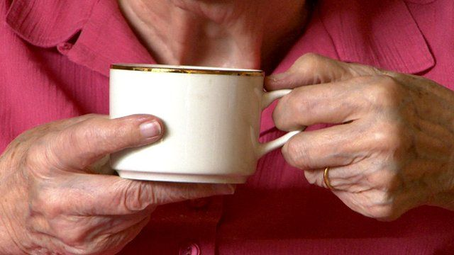 An elderly woman's hands