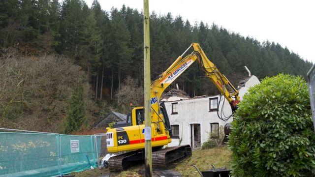 Mark Bridger's cottage in Machynlleth is demolished by a bulldozer